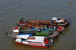 Several barges moored at Thames River