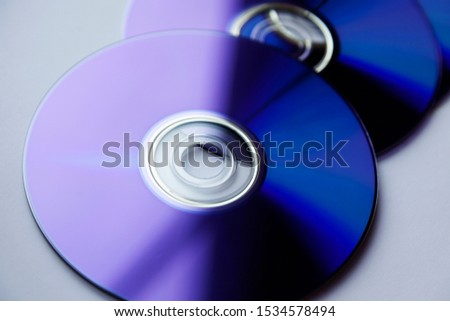 several blu ray discs are in the window on light background