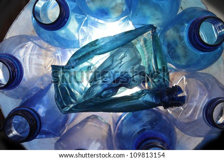 several blue empty crushed plastic bottles