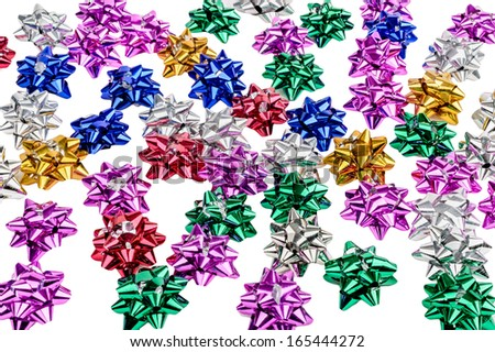Several blue, red, white, yellow and pink metallic bows.