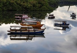 Several boats moored. Reflection of the sky in the sea.