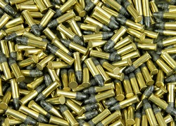 Several Brass cased bullets make a bullet background