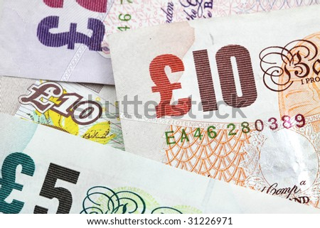 Several british banknotes as a money background