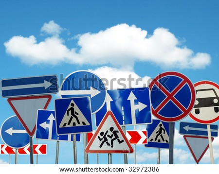several caution signs of the road on sky background