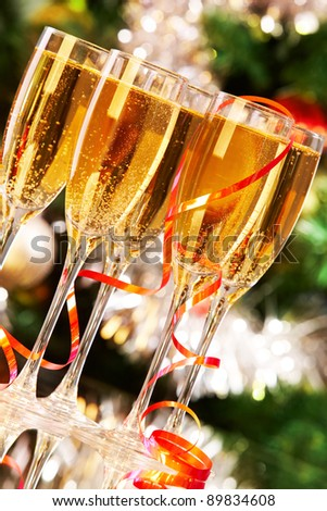 Several champagne flutes on Christmas background