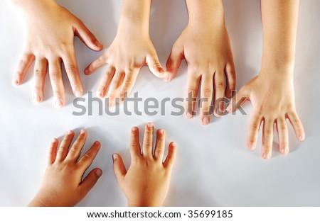 Several children hands together on white background