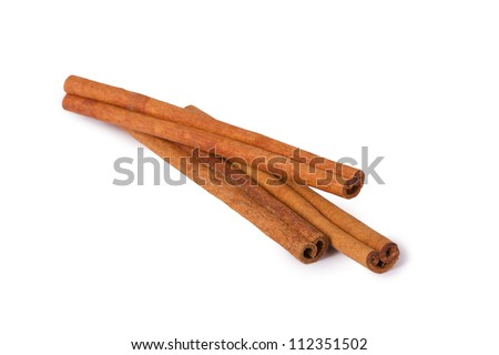 Several cinnamon sticks isolated on white background