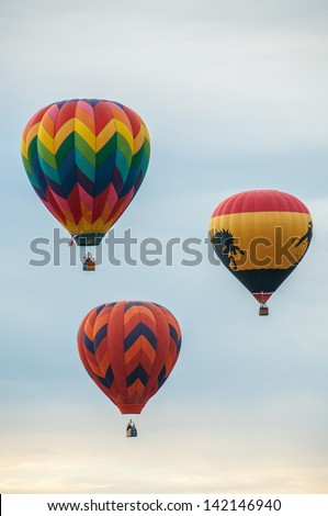 Several colorful hot air balloons rising