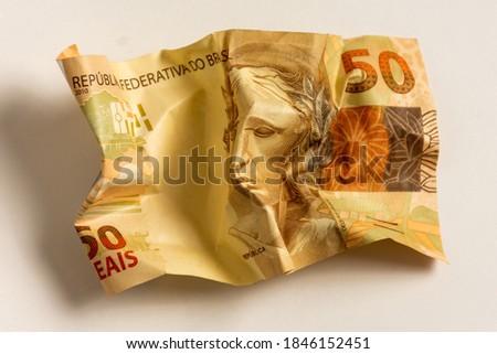 Several crumpled Brazilian money bills Photo stock ©