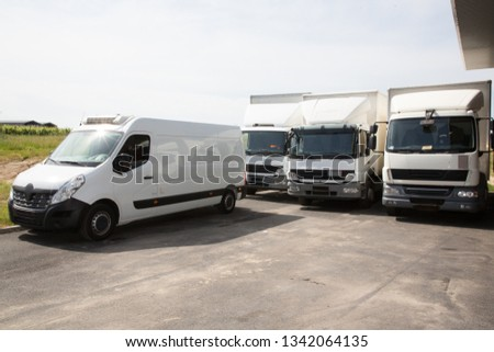 several delivery van and white logistic truck for service transportation in distribution park #1342064135