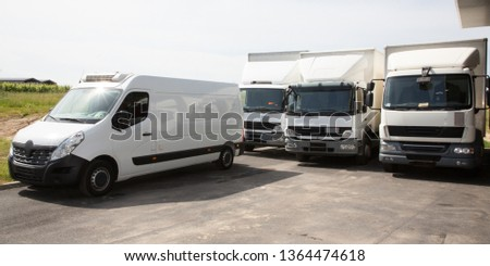 several delivery van white logistic truck for service transportation distribution #1364474618