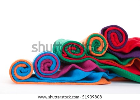 Several different colorful fabric socks rolls