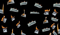 Several 100 dollar bills, falling down, burn on a black background. The concept of bankruptcy, depreciation, devaluation, wastefulness and waste of money. Isolated.