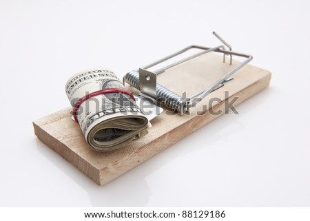 several dollar bills with elastic band  set on a mouse-trap #88129186