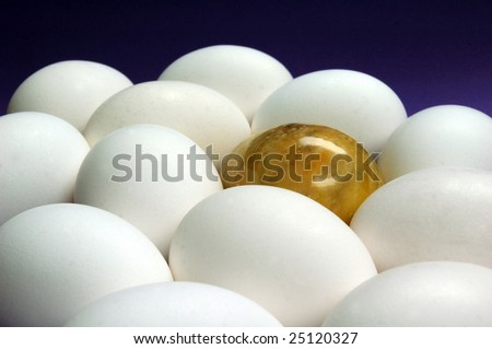 Several eggs with golden marble egg in a group