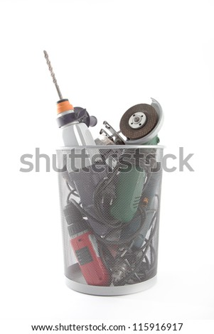 Several electric hand tools in a dustbin.