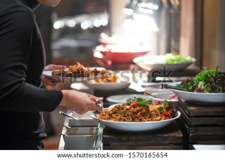 several food on buffet line catering