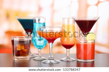 Several glasses of different drinks on bright background #133788347