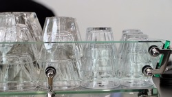 Several glasses were placed on the glass shelf.