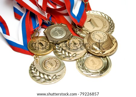 Several golden medals isolated on white