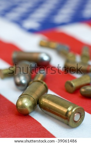 several gun and rifle ammunition of american flag