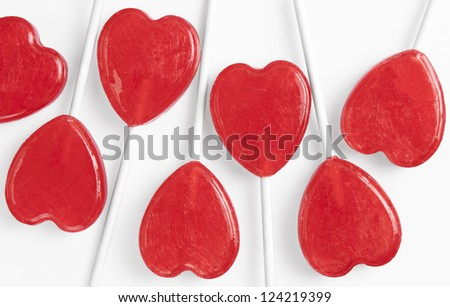 Several heart shaped lollipops isolated on white