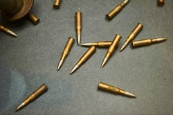 Several large-caliber bullets lying in a chaotic