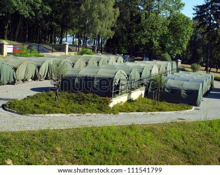 several large military tents as a camp for junior