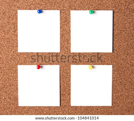 Several message papers pinned to cork board