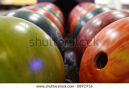 several multicolored balls for playing bowling