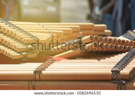 Several Native American Hispanic ethnic wind flutes Pan. Multi-barreled flute. #1082696510