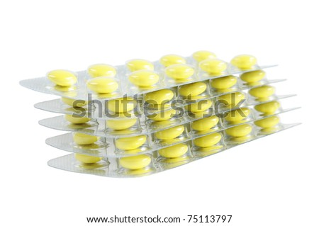 Several packs of yellow pills. Isolated on white.