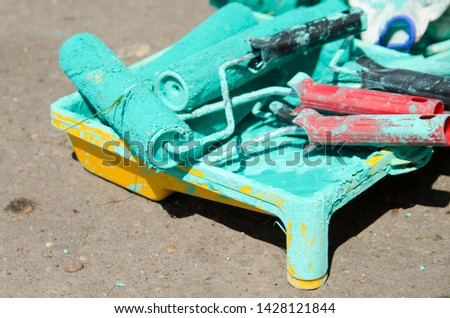 Paint roller in paint tray  DIY decorating tools  Images and