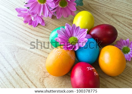 Several painted Easter eggs laid on wooden table