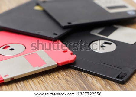 Several parquet floppy disks on the table, close-up.