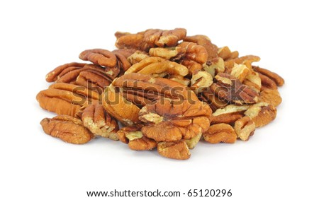 Several pecan nuts on a white background.