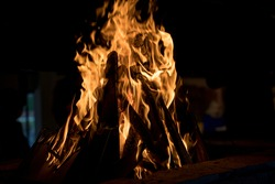 Several pieces of firewood engulfed in flames
