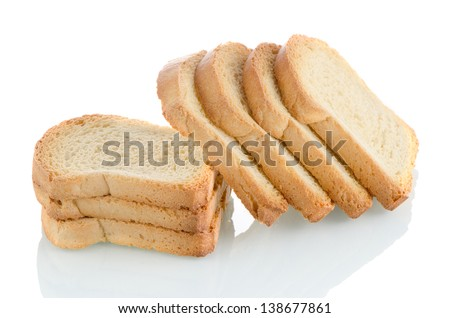 Several pieces of golden brown toast on white background.