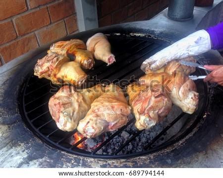 Several pork leg grilled on the burner. #689794144