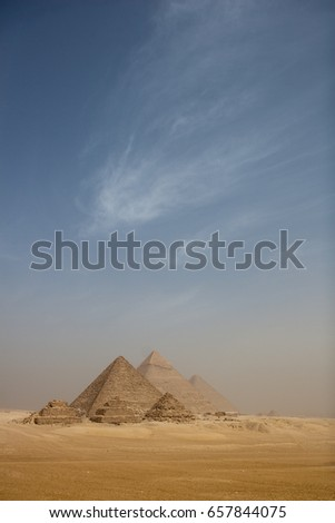 Shutterstock several pyramids with blue sky and creamy clouds / Cario, Egypt