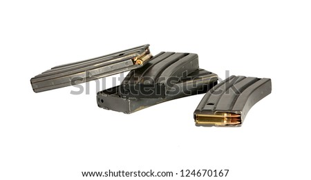 Several 30 round high capacity magazines for AR-15 and AR-16 assault rifles loaded with 5.56 mm ammunition.