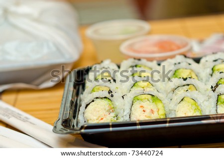 Several sets of sushi to go. Shallow Depth-Of-Field. Focus on the closest rolls.
