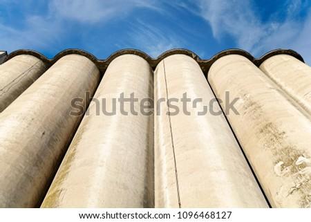 Several Silos farm agriculture tank with cloudy sky