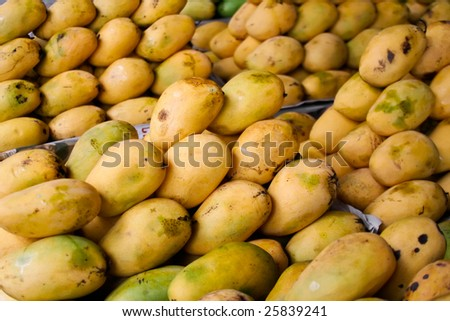 Several stacks of Philippine mangoes at grocery