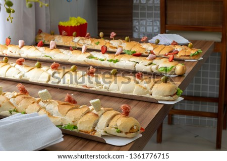 several sub sandwiches (submarine, sub, wedge, hoagie, hero or g #1361776715