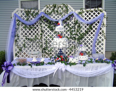 stock photo Several tier white wedding cake with purple accents