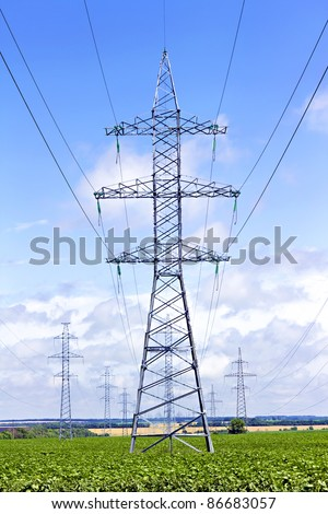 several transmission lines in the middle of a  field