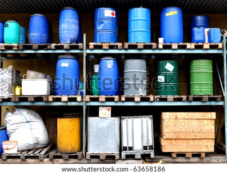 Several types of drums and barrels in a warehouse
