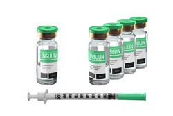 several vials of insulin and an insulin syringe. isolated