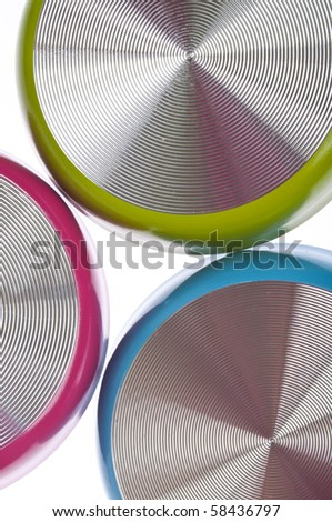 Several Vibrant Frying Pans Isolated on White.